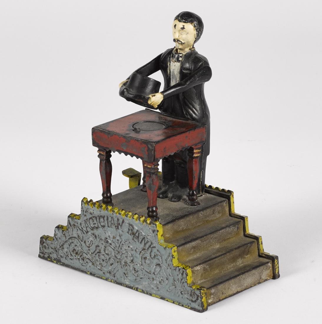 J. & E. Stevens cast iron Magician mechanical bank.