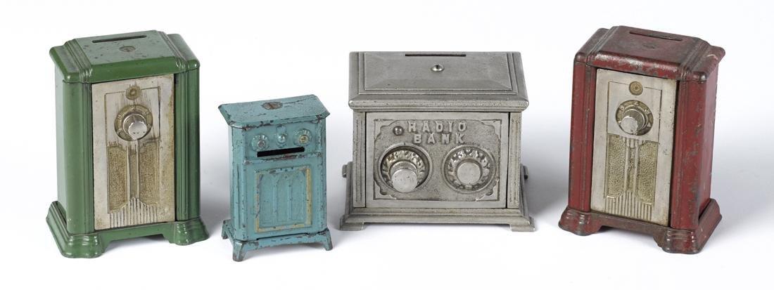 Four cast iron radio still banks, to include three