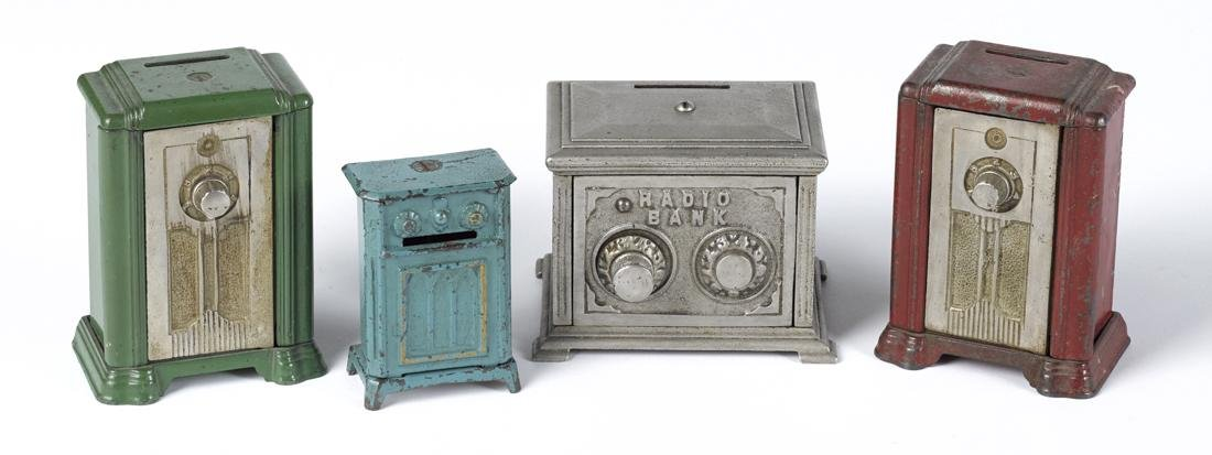 Four cast iron radio still banks, to include three