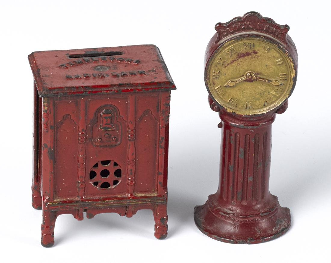 Two cast iron still banks, to include a street Clock