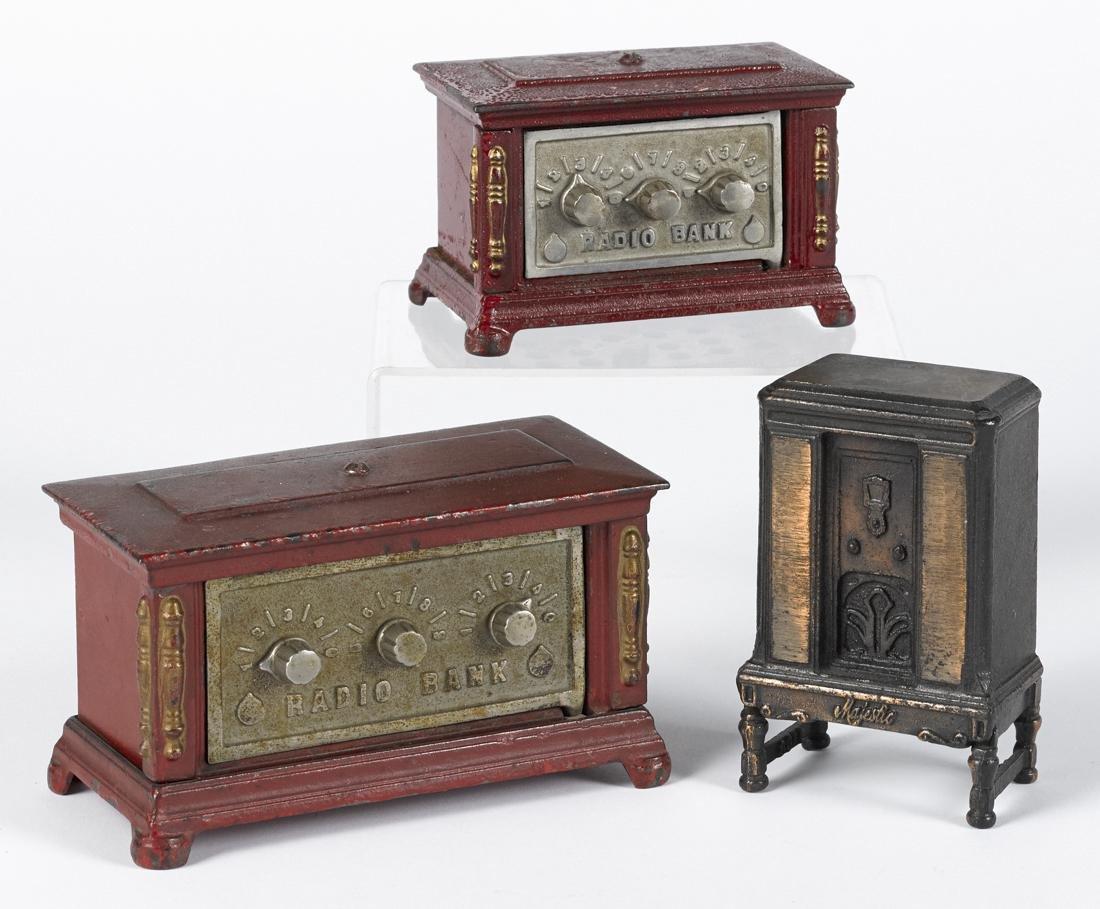 Three cast iron radio still banks, to include Arcade