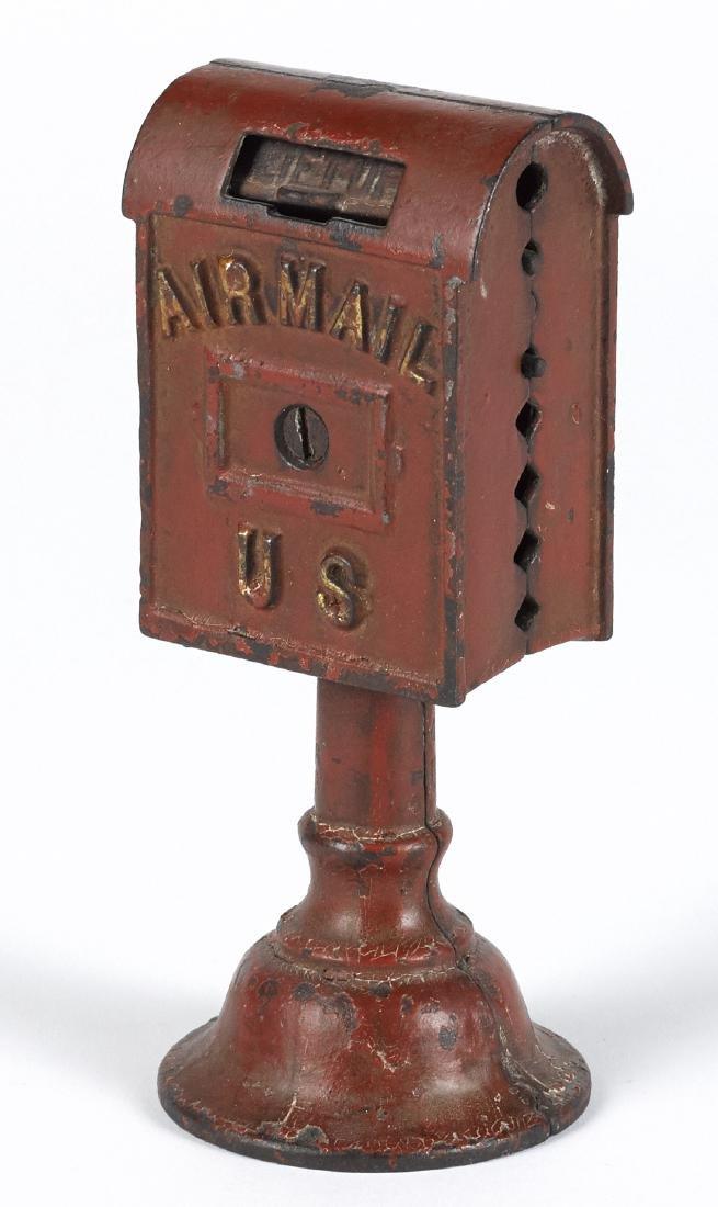 Dent cast iron Airmail still bank, 6 3/8'' h.