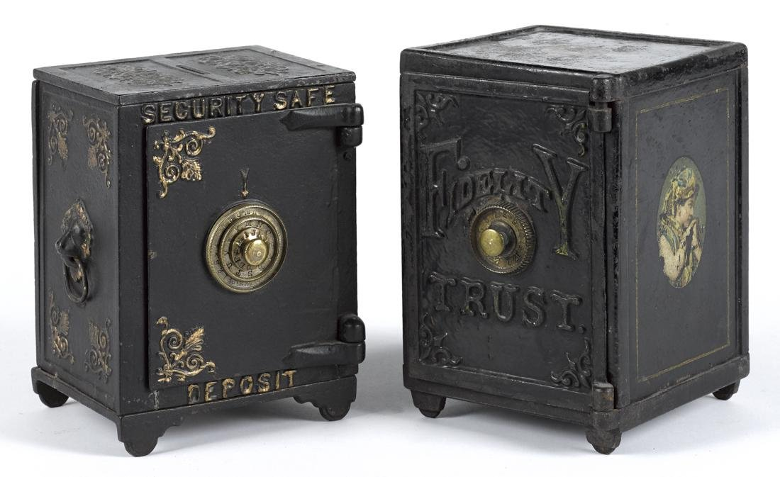 Two large cast iron safe still banks, to include a