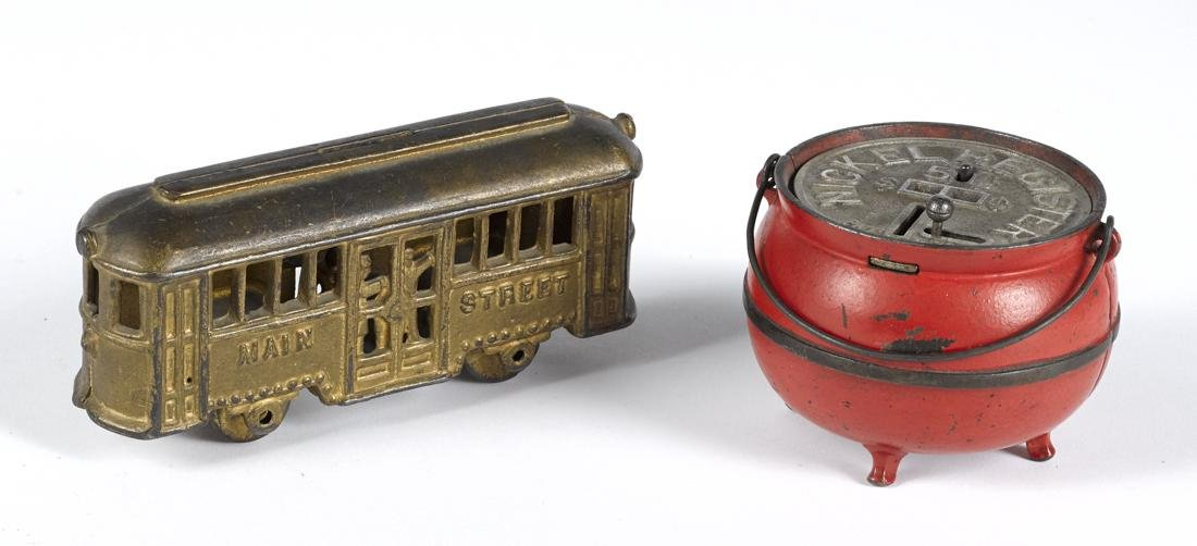 Two cast iron still banks, to include an A. C. Williams