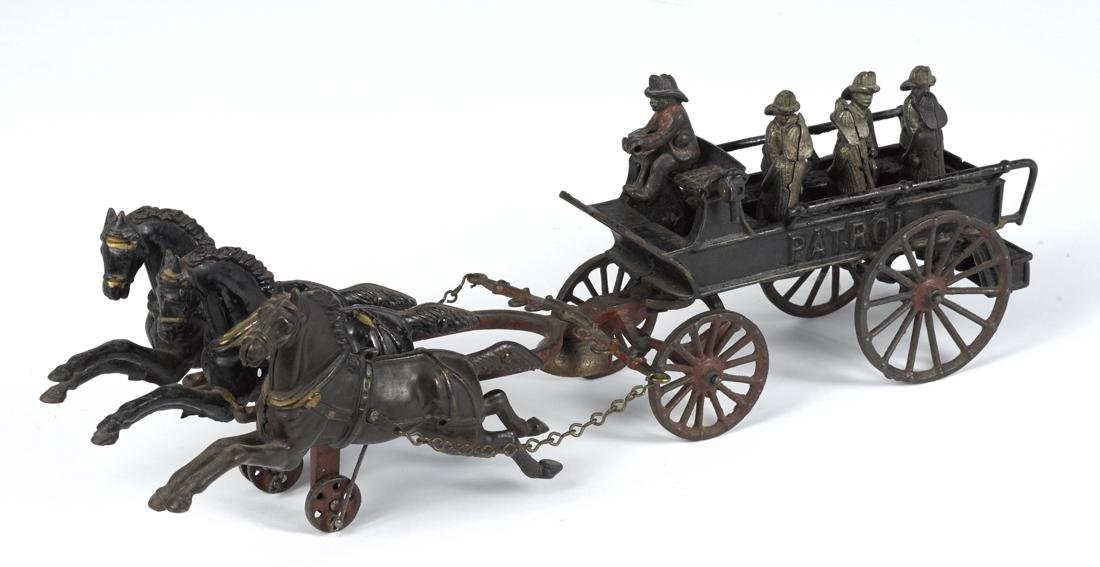 Dent cast iron horse drawn Patrol wagon with an unusual