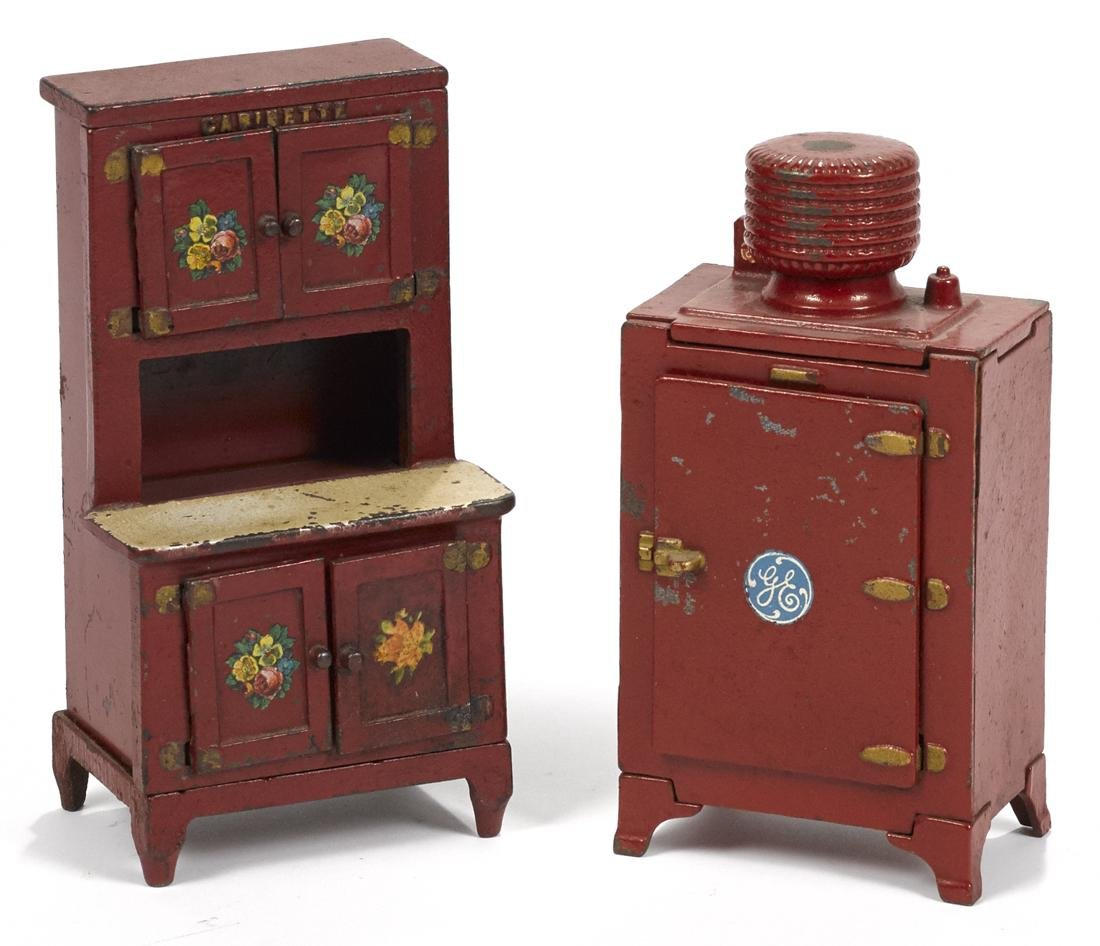 Two Hubley cast iron red refrigerators, to include a