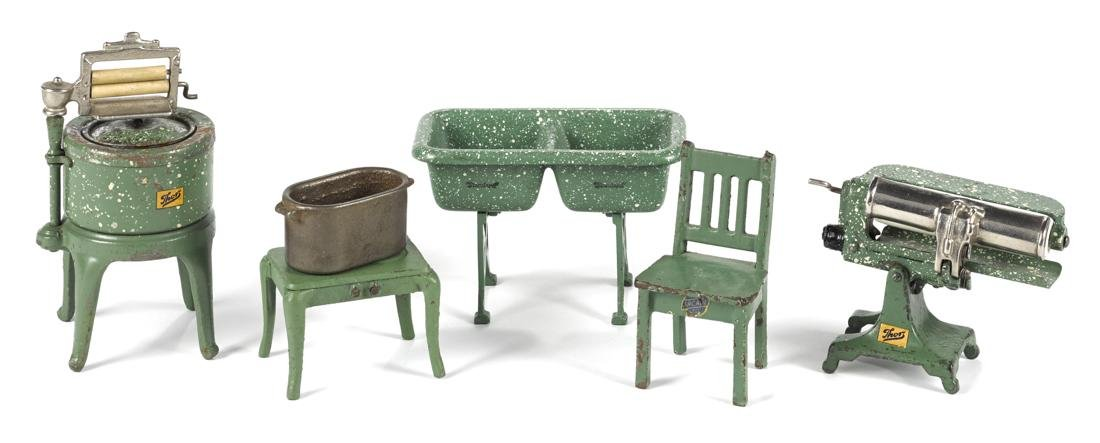 Arcade cast iron five-piece laundry set, to include a