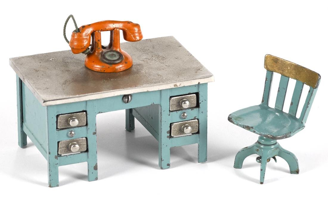 Kenton cast iron blue knee hole desk, 2 3/4'' h., with