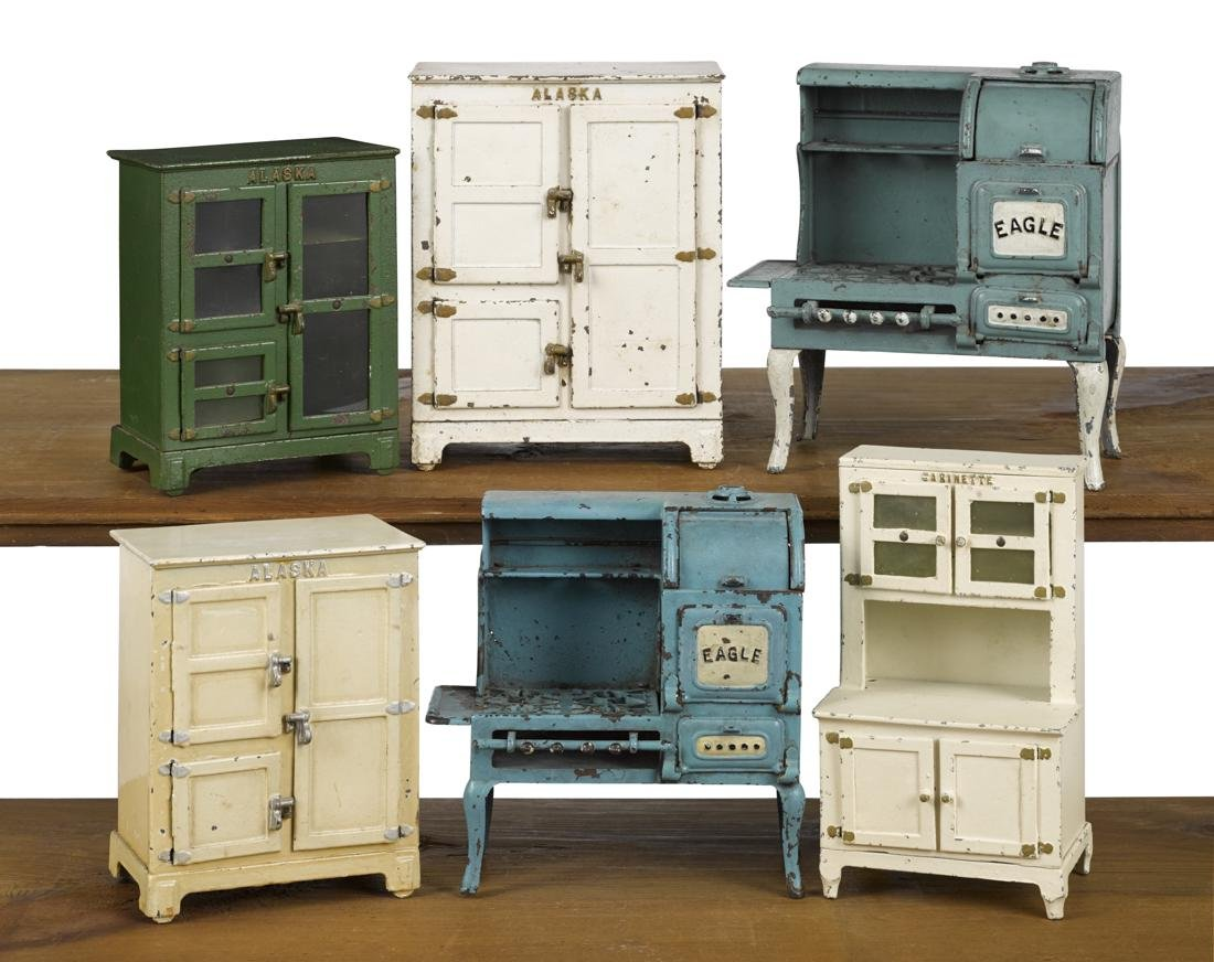 Six Hubley cast iron kitchen stoves and refrigerators,