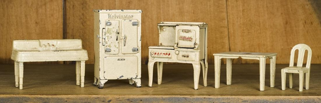 Arcade cast iron five-piece kitchen set, to include a