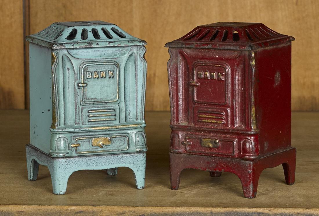Two Kenton cast iron and tin parlor stove still banks,