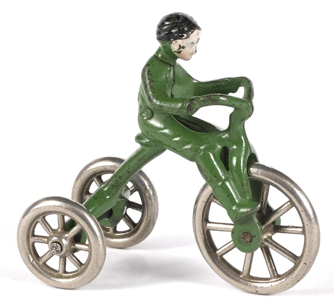 Hubley cast iron tricycle with a rider, 4 1/2'' h.