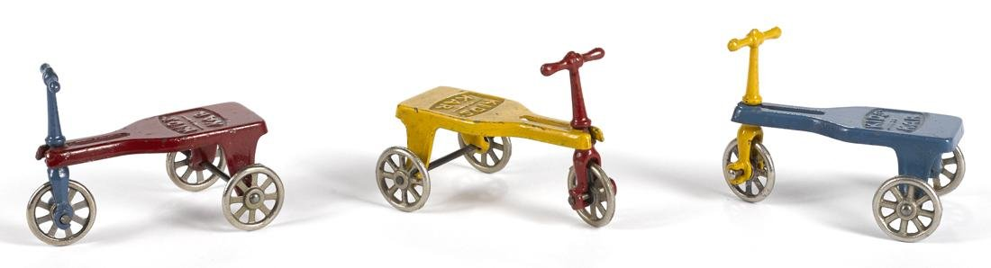 Three Kilgore cast iron Kids Kar tricycles, 3 3/4'' h.
