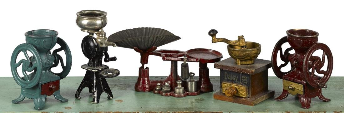 Four Arcade cast iron kitchen toys, to include two