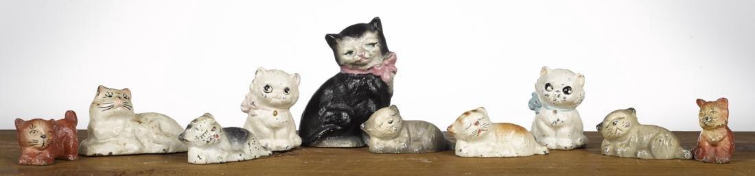 Ten Hubley cast iron cat paperweights and figures,
