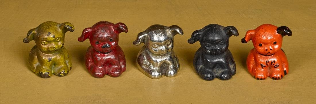 Five Hubley cast iron advertising pup paperweights, to