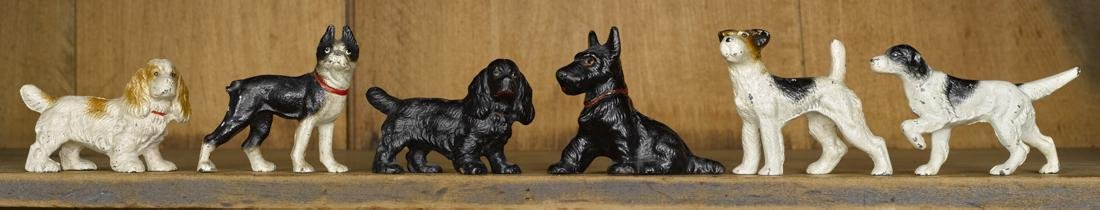 Six Hubley cast iron dog paperweights and figures,