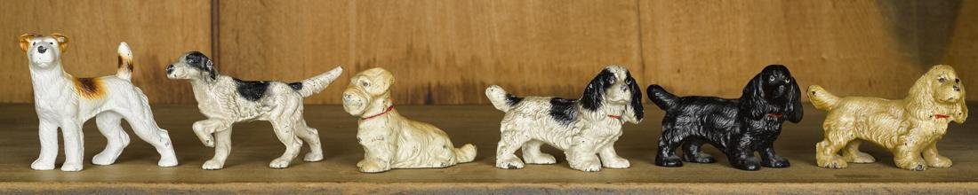 Six Hubley cast iron dog paperweights, tallest - 3''.