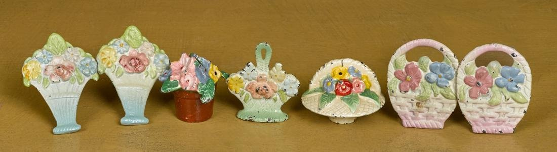 Seven Hubley cast iron flower paperweights and