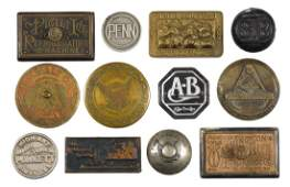 Twelve cast iron advertising paperweights to include