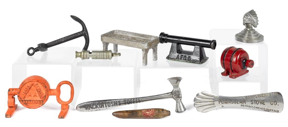 Ten cast iron paperweights and novelties, to include