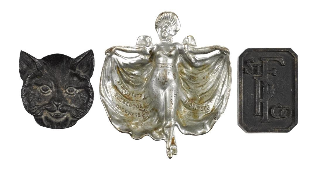 Three cast iron advertising pieces, to include a Kenton