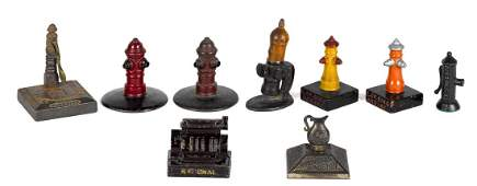 Nine cast iron advertising paperweights and novelties