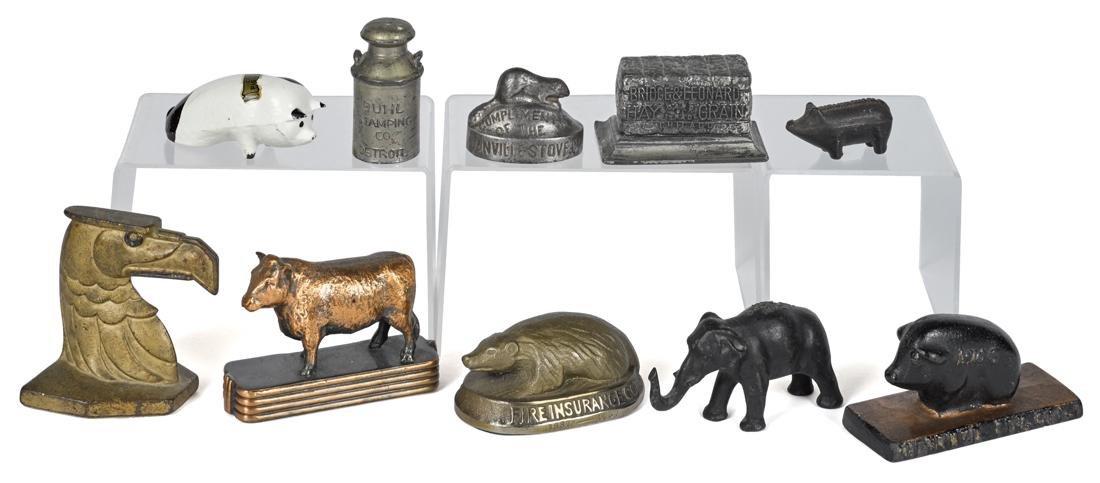 Ten cast iron advertising paperweights and novelties,