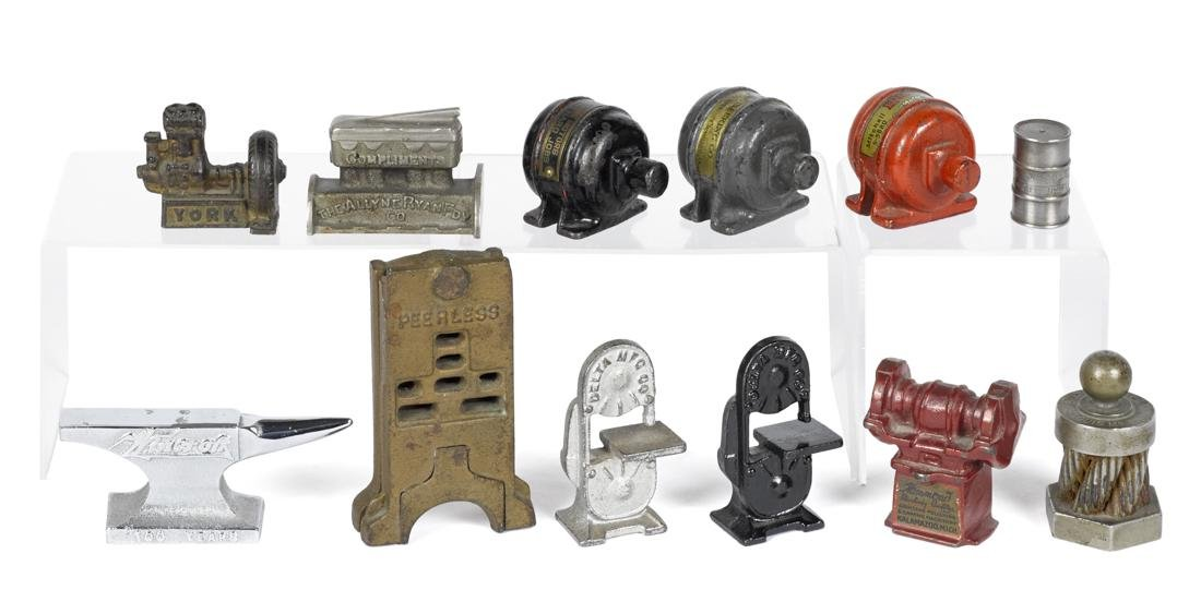 Twelve cast iron advertising machine paperweights, to