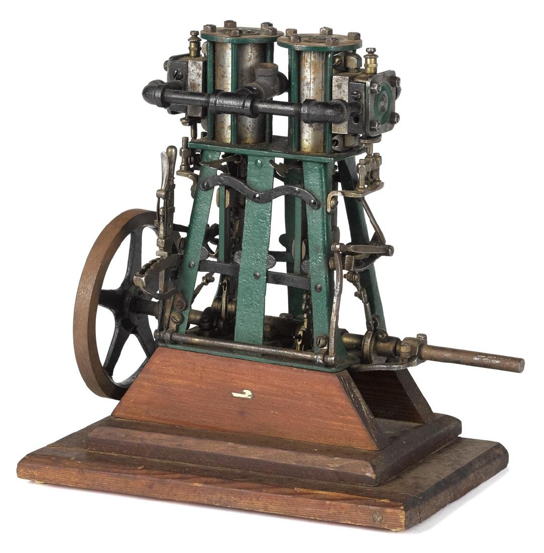 Vertical two cylinder engine, 13 1/2'' h.