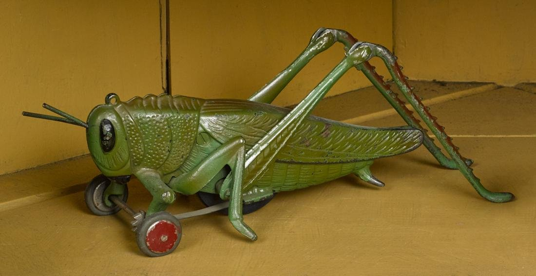 Hubley cast iron grasshopper pull toy with aluminum