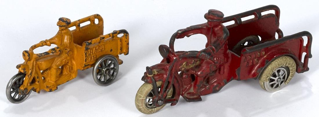 Two Hubley cast iron Crash Car three-wheel motorcycles,
