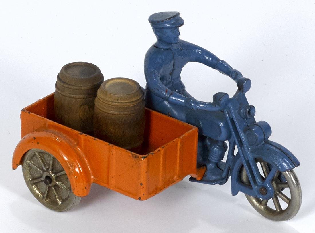 Kilgore cast iron delivery motorcycle with a sidecar,
