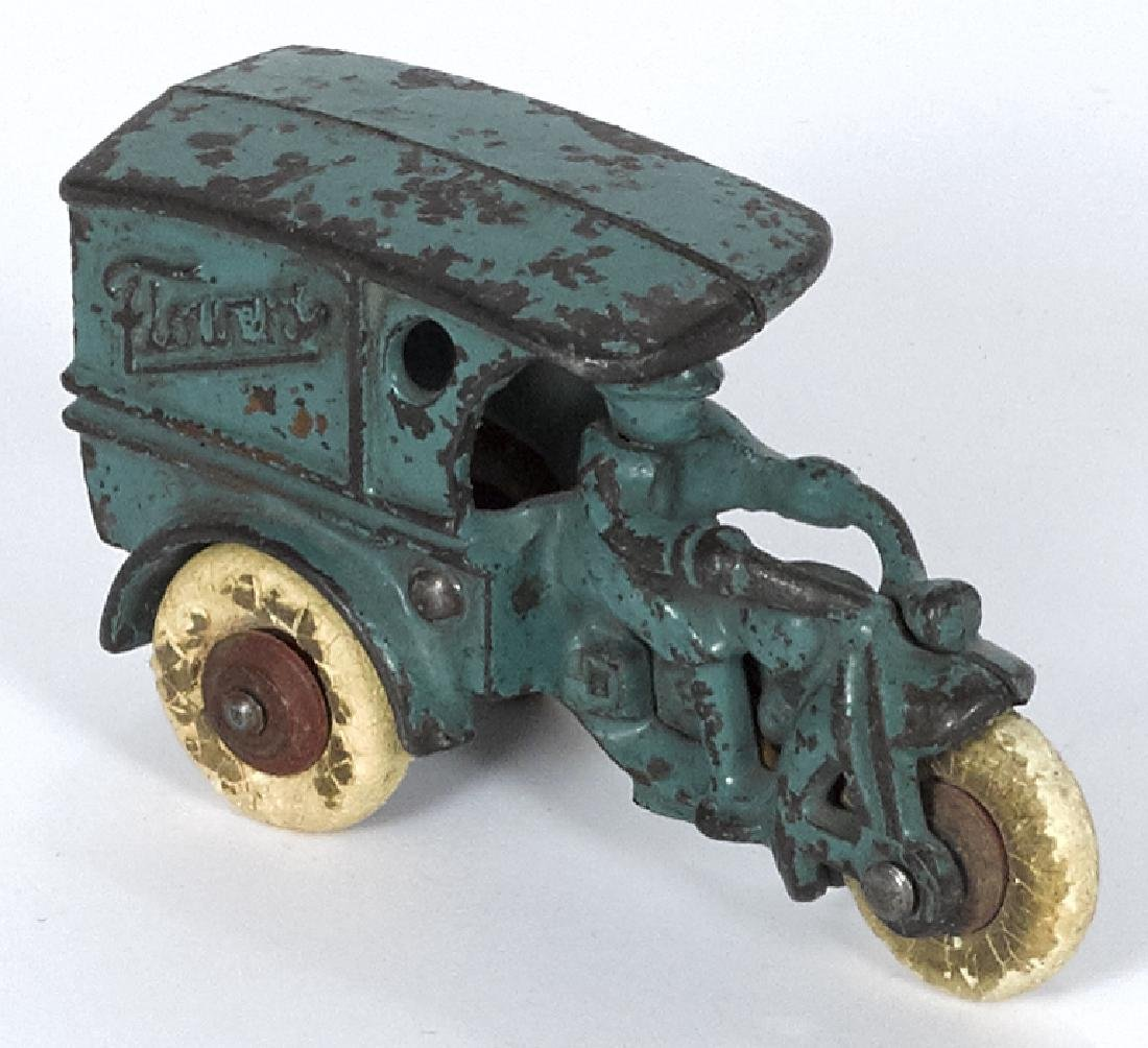 Hubley cast iron Flowers three-wheel delivery