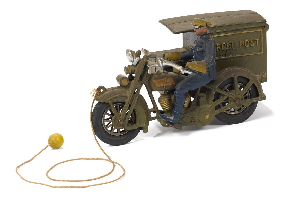 Hubley cast iron Parcel Post motorcycle with a police