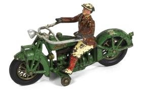 Hubley cast iron Indian motorcycle with a civilian
