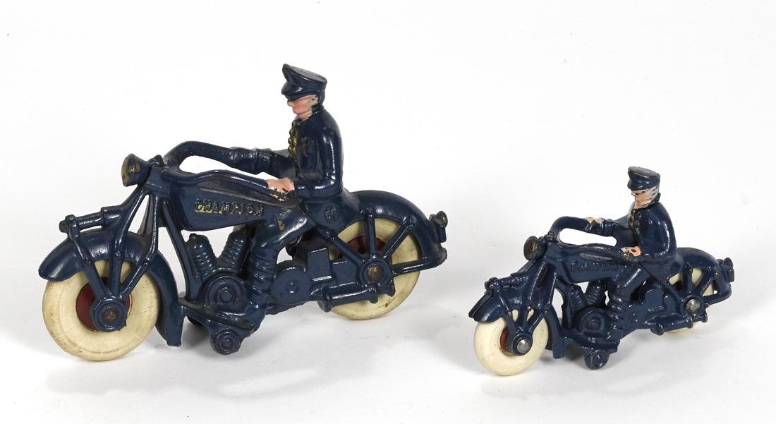 Two Champion cast iron police motorcycles, 7'' l. and