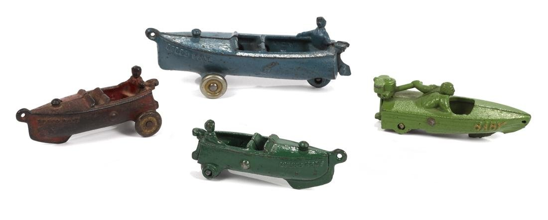 Four cast iron speed boats, to include three A.C.
