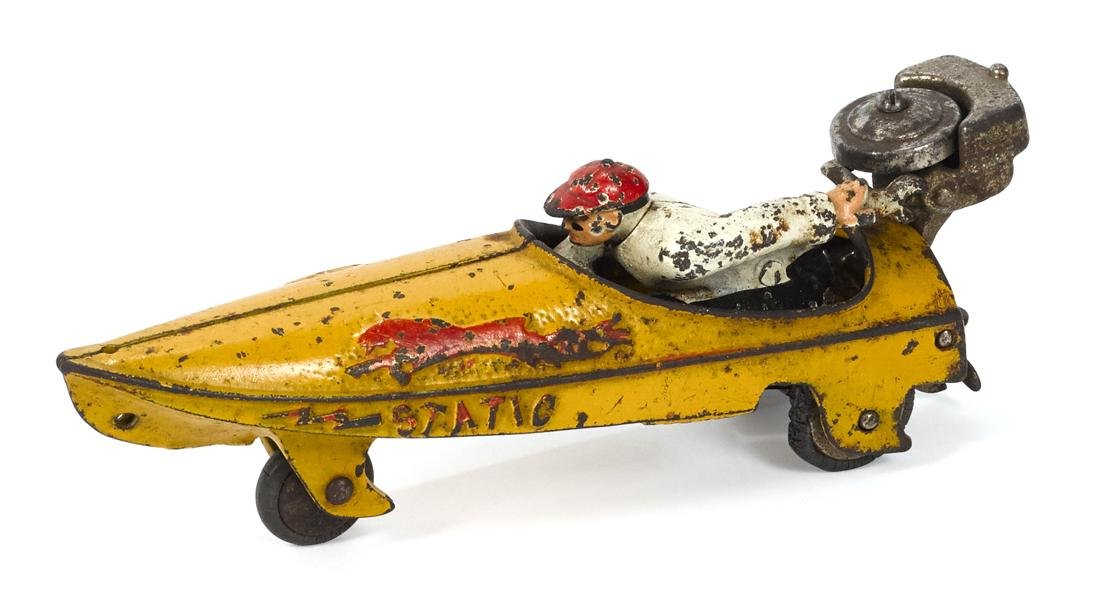 Hubley cast iron Static speed boat with a seated driver