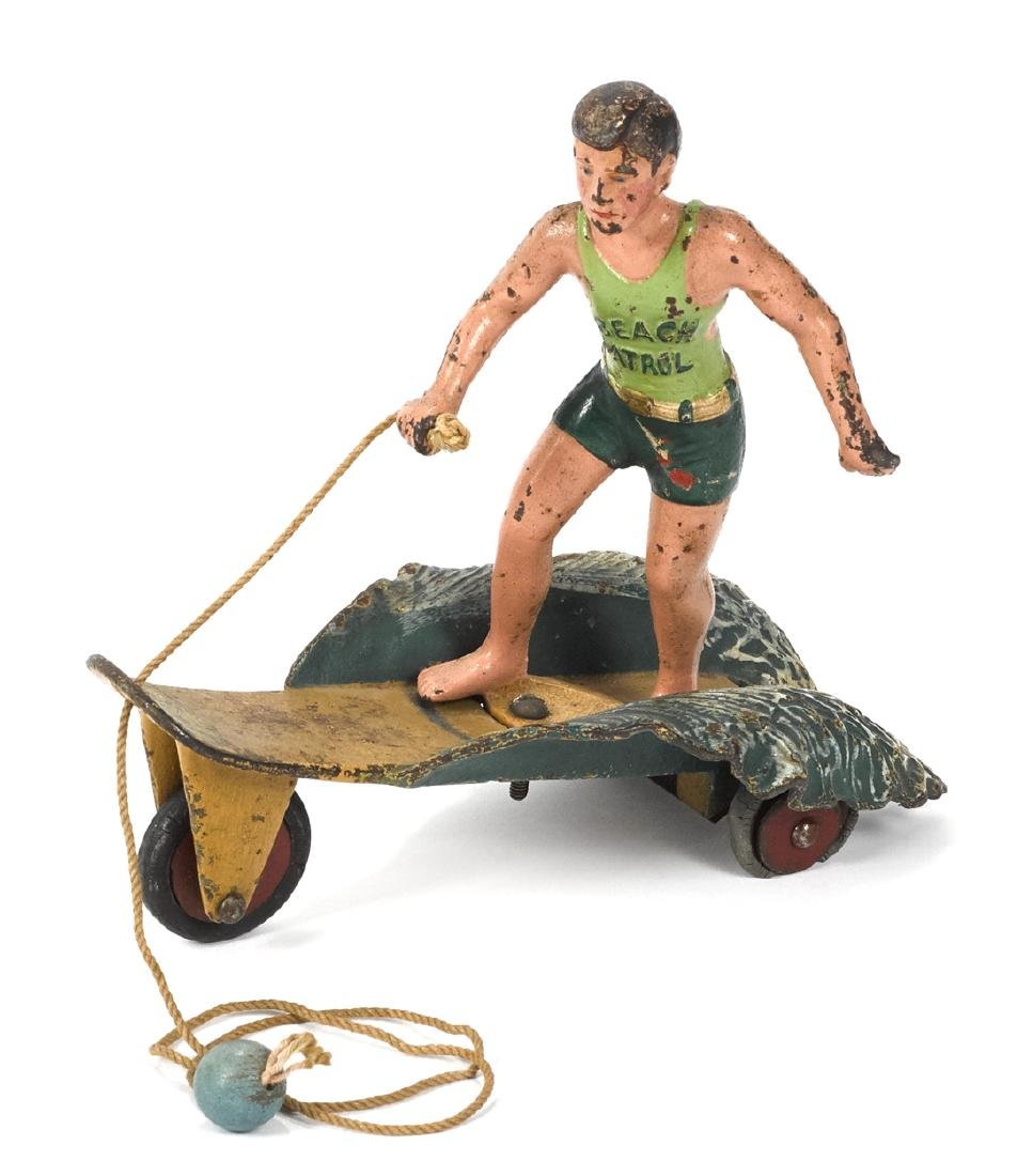 Hubley cast iron ''Surfer Boy'' pull toy, retaining the