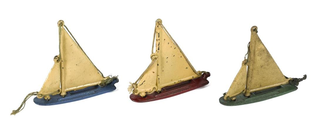 Three Kilgore cast iron sailboats, 3 1/2'' h.