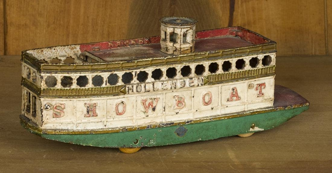 Arcade cast iron Hollenden Showboat pull toy, 10 3/4''