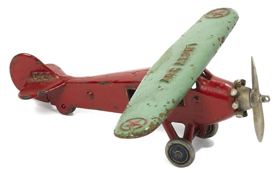 Unusual Dent cast iron Lucky Boy airplane in two