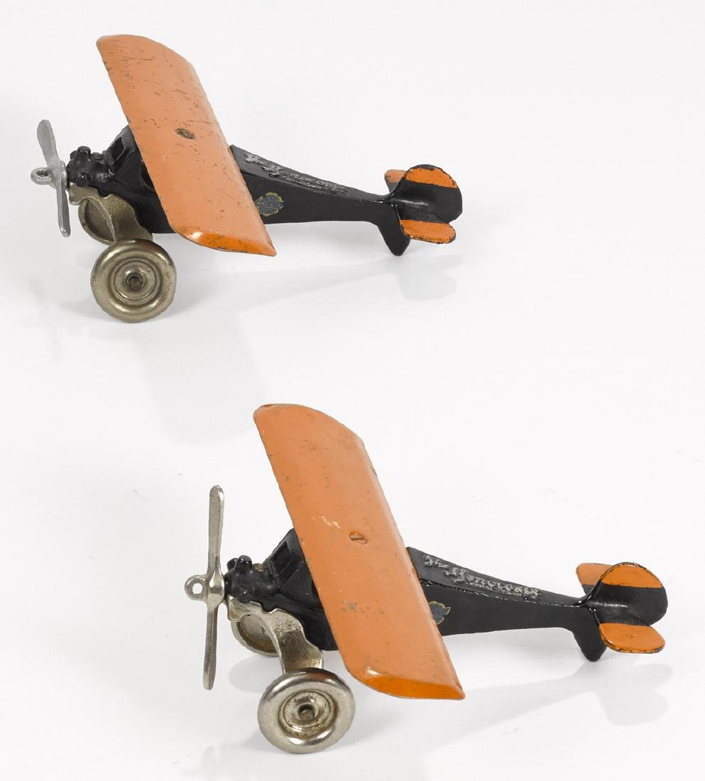 Pair of Arcade cast iron The Monocoupe airplanes with
