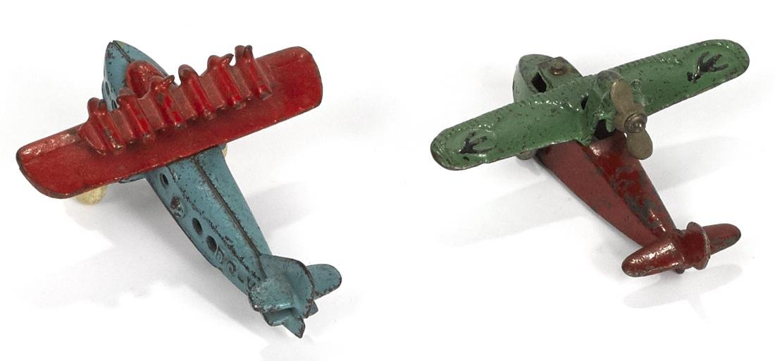 Two small cast iron airplanes, to include a Kilgore - 2