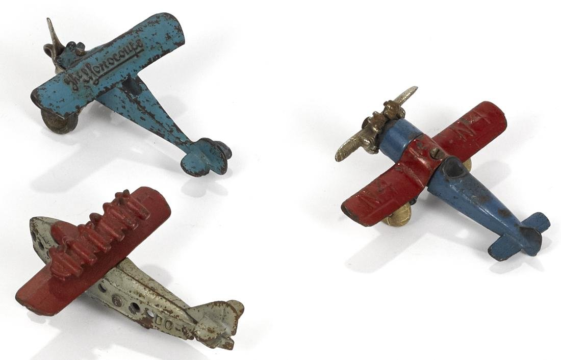 Three small cast iron airplanes, to include an Arcade - 2