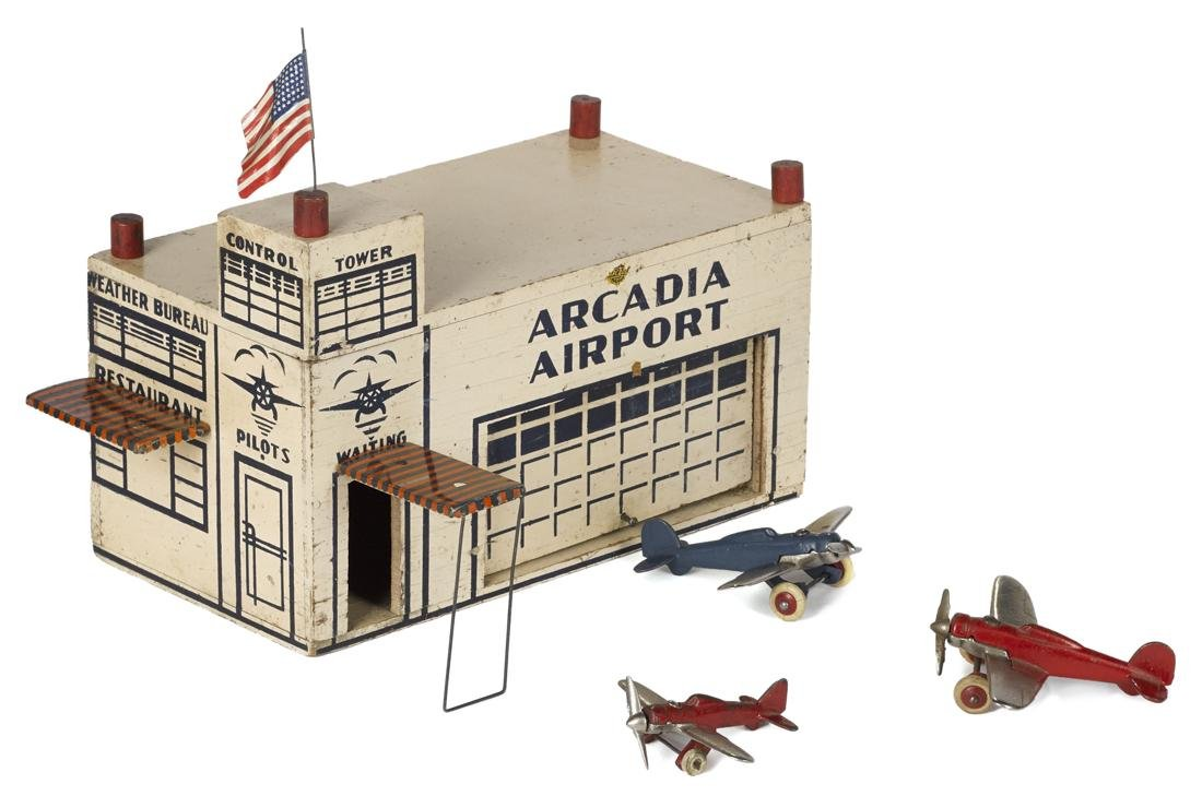 Arcade painted wood Arcadia Airport terminal with tin