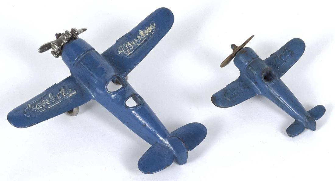 Two Kilgore cast iron airplanes, to include a Travel - 2