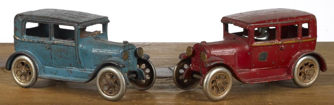 Two Arcade cast iron sedans, tudor and four-door, with