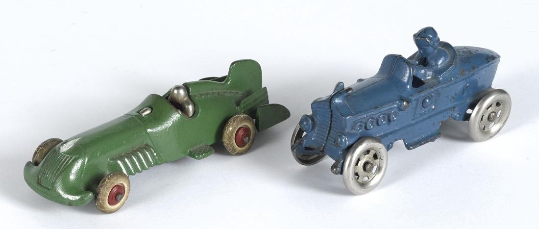 Two cast iron racers, to include an A.C. Williams with